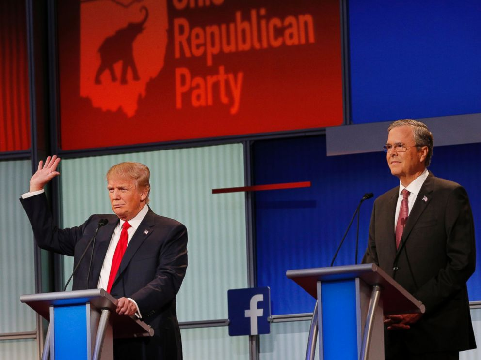 PHOTO: Donald Trump raises his hand to say that he will not take a pledge not to run as an Independent candidate for president as former Governor Jeb Bush looks on at the first Republican presidential candidates debate in Ohio, Aug. 6, 2015.