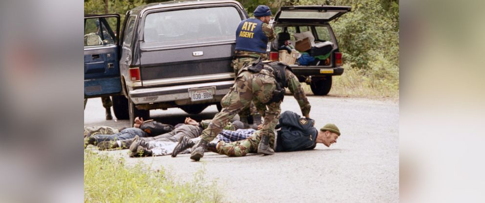 PHOTO: An agent of the Bureau of Alcohol Tobacco and Firearms places one of five men on the ground after their arrest near a police barricade near the site of a four-day standoff with white supremacist, Randy Weaver near Naples, Idaho, Aug. 25, 1992.