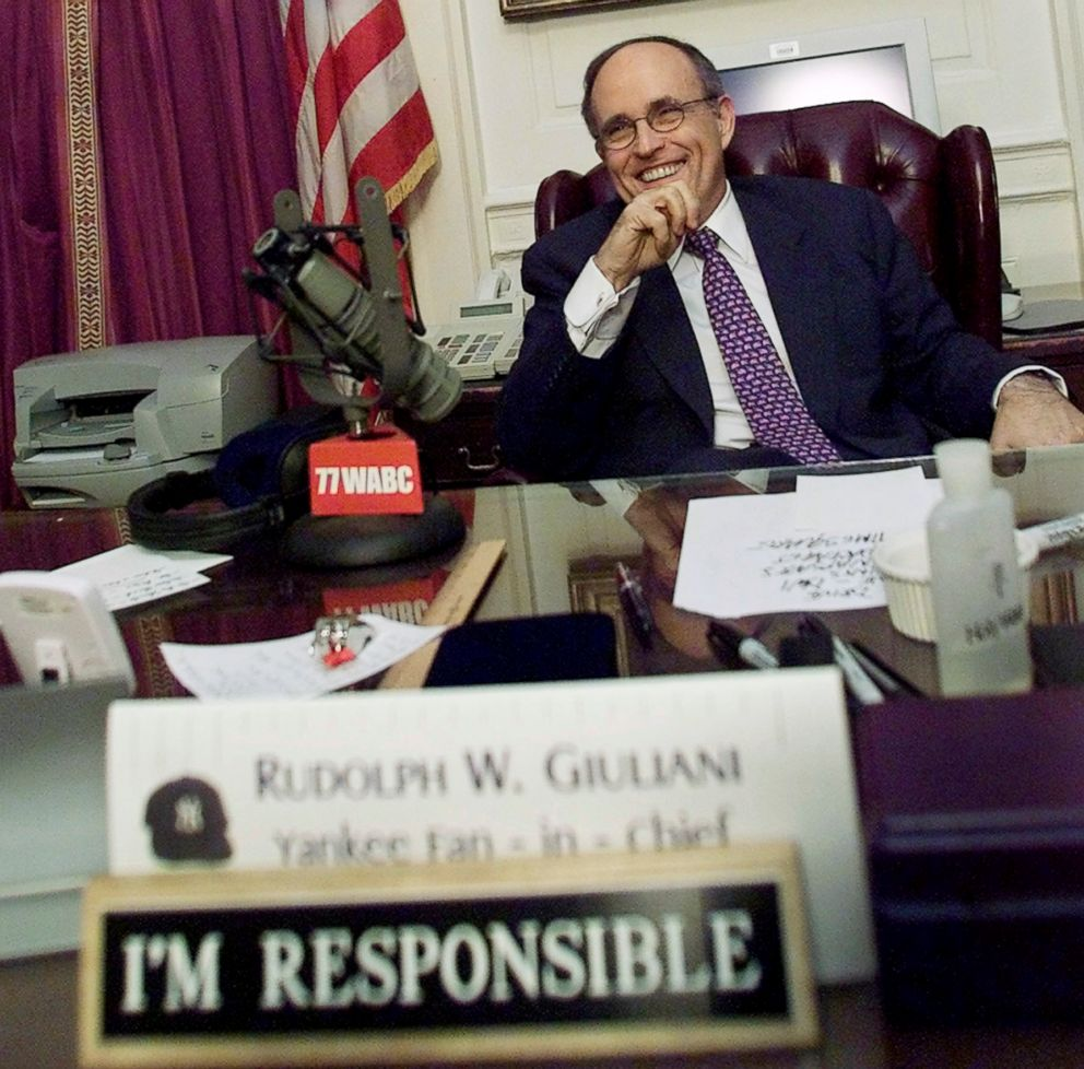 PHOTO: New York City Mayor Rudolph Giuliani smiles as he takes a break during his final live radio show, Dec. 28, 2001, at his City Hall office in New York.