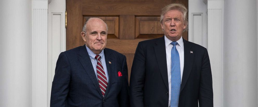 PHOTO: Former New York City mayor Rudy Giuliani, left, stands with president-elect Donald Trump before their meeting at Trump International Golf Club, Nov. 20, 2016 in Bedminster Township, N.J.