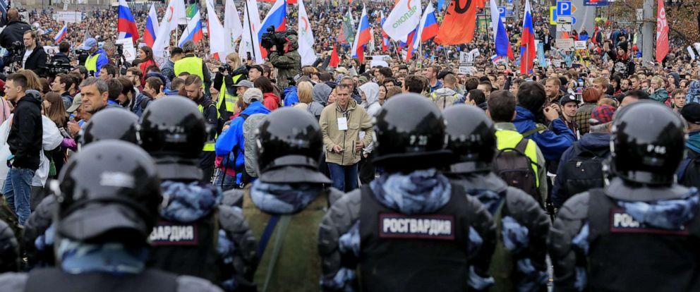 PHOTO: Law enforcement officers stand guard during a rally to demand authorities allow opposition candidates to run in the upcoming local election in Moscow, Aug. 10, 2019.