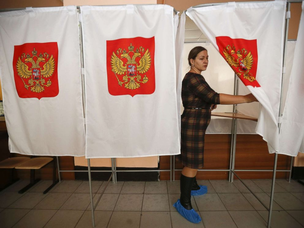 PHOTO: A member of a local electoral commission walks out of a voting booth at a polling station during preparations for the upcoming presidential election in Moscow, March 16, 2018.