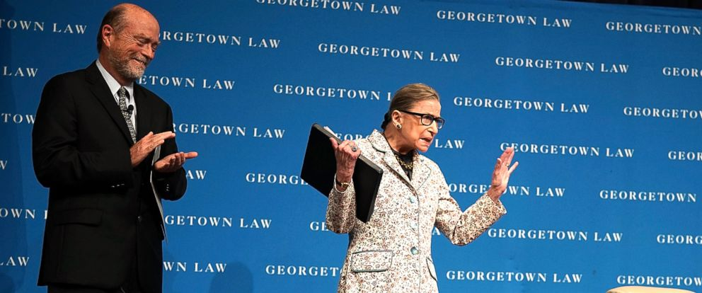 PHOTO: U.S. Supreme Court Justice Ruth Bader Ginsburg (R) waves to students as she arrives at a lecture on Sept. 26, 2018, at Georgetown University Law Center in Washington, D.C.