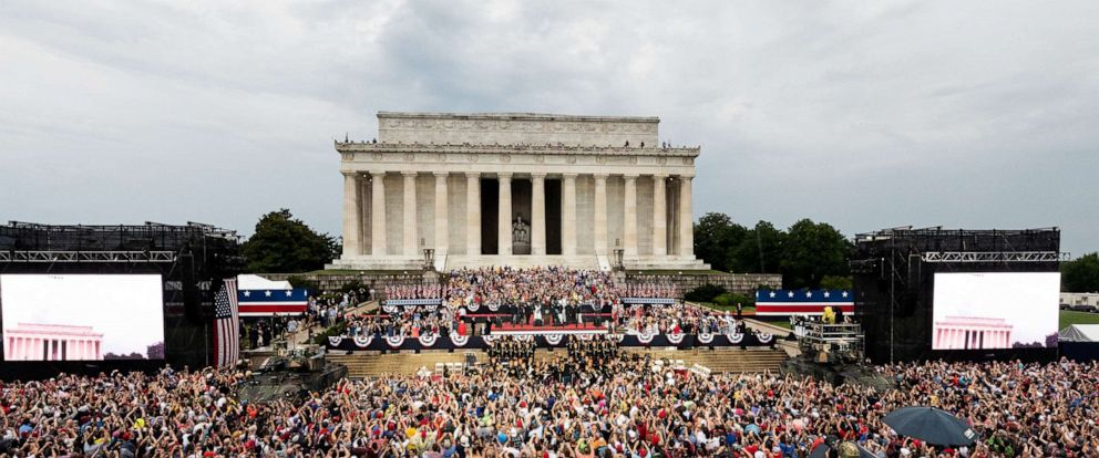 PHOTO: President Donald Trump speaks at the National Mall as a military flyover takes place during the Salute To America event on July 4, 2019 in Washington.