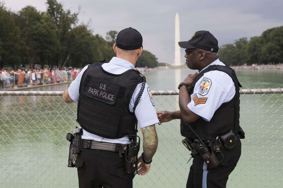 PHOTO: Members of the U.S. Park Police talk during the opening festivities of President Donald Trumps Salute to America ceremony in front of the Lincoln Memorial, on July 4, 2019, in Washington.