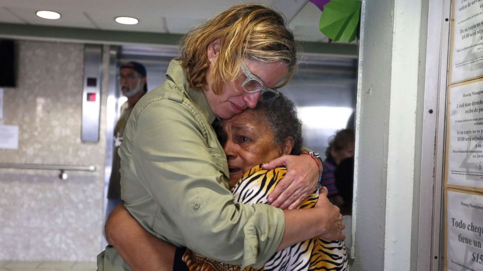 San Juan's Mayor Carmen Yulin Cruz, left, hugs a woman during her visit to an elderly home in San Juan, Puerto Rico, Sept. 22, 2017.