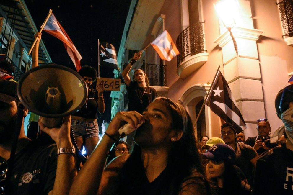 PHOTO: Demonstrators chant, sing, and wave Puerto Rican flags during the sixth day of protest calling for the resignation of Governor Ricardo Rossello in San Juan, Puerto Rico, July 18, 2019.