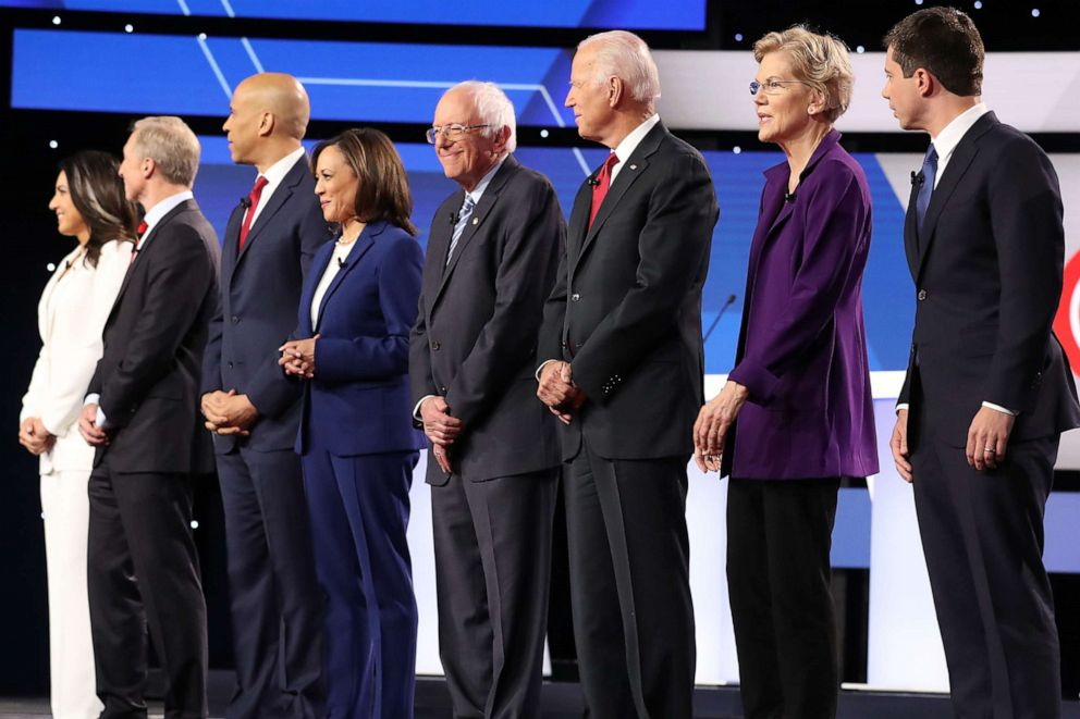 PHOTO: Democratic presidential candidates are seen before the start of the Democratic Presidential Debate at Otterbein University on October 15, 2019 in Westerville, Ohio.