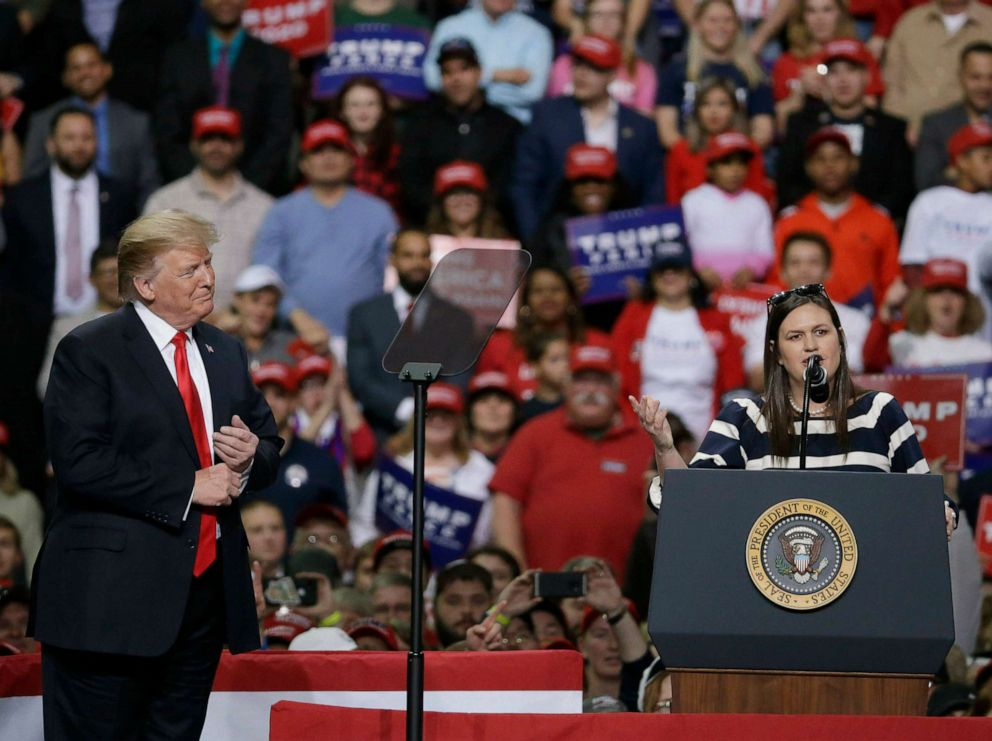 PHOTO:President Donald Trump listens to White House Press Secretary Sarah Huckabee Sanders speak at a Make America Great Again rally, April 27, 2019, in Green Bay, Wis.