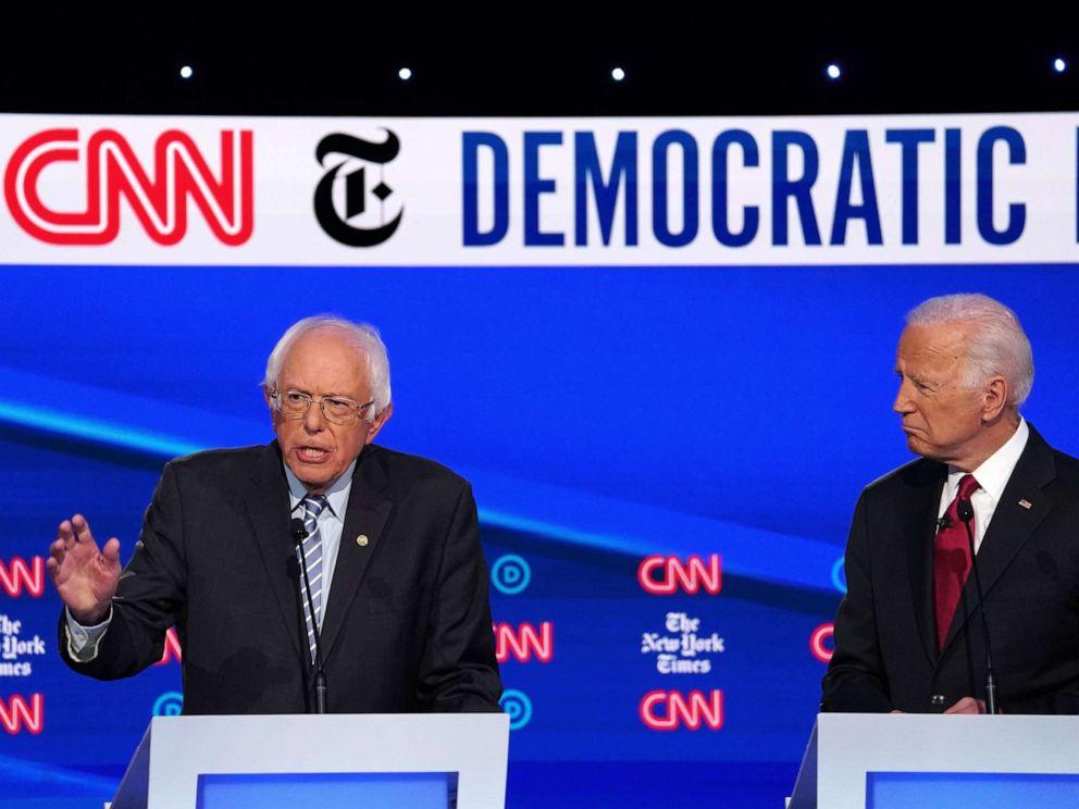 PHOTO: Former Vice President Joe Biden looks on as Senator Bernie Sanders speaks during the fourth Democratic presidential debate at Otterbein University in Westerville, Ohio, Oct. 15, 2019.