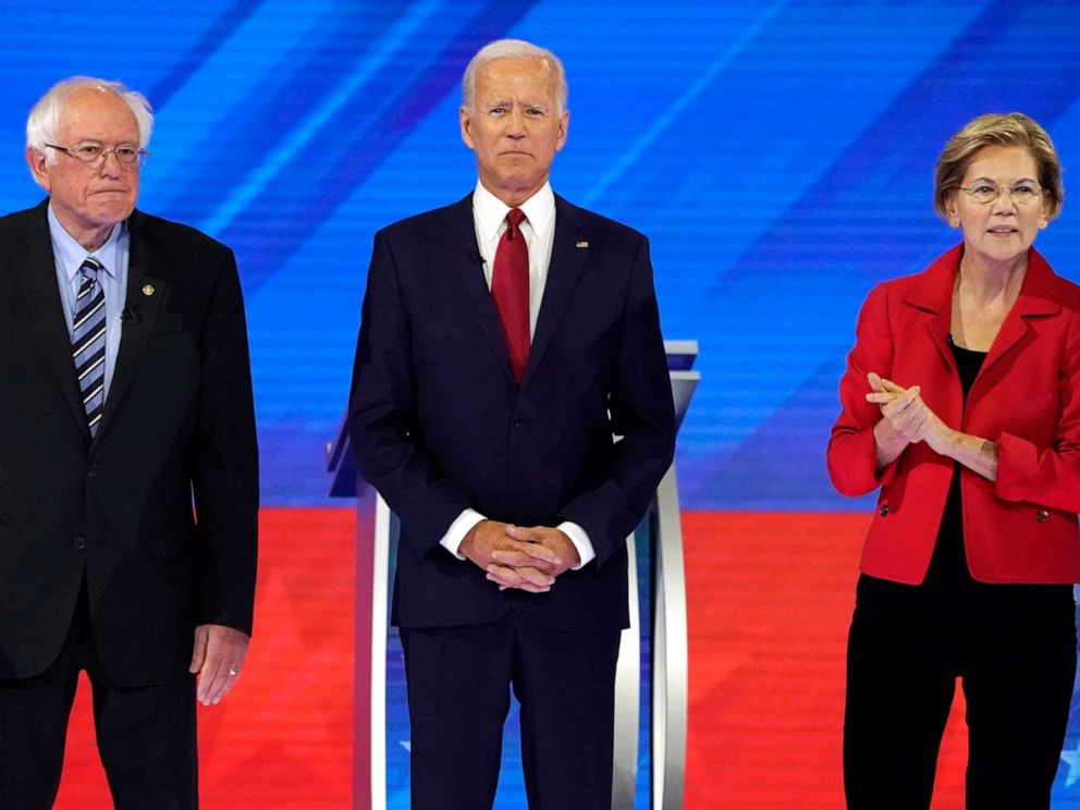 PHOTO: Senator Bernie Sanders joins former Vice President Joe Biden and Senator Elizabeth Warren onstage before the start at the 2020 Democratic U.S. presidential debate in Houston, Sept.12, 2019.