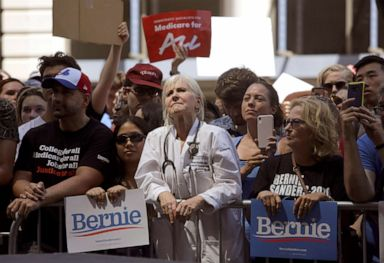 PHOTO: Dr. Rene Rubin listens to Democratic presidential candidate Bernie Sanders, make remarks at a rally alongside unions, hospital workers and community members against the closure of Hahnemann University Hospital in Philadelphia, July 15, 2019.