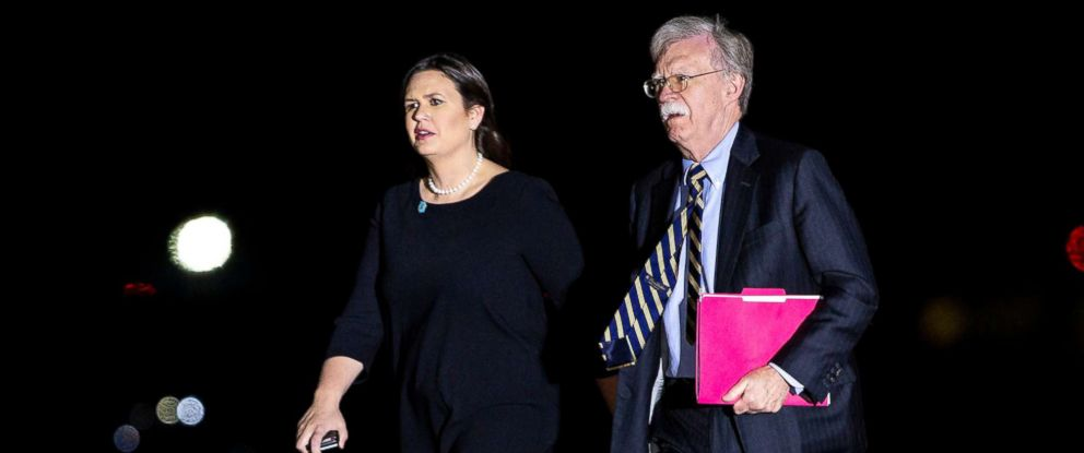 PHOTO: Sarah Huckabee Sanders and John Bolton arrive behind U.S. President Donald Trump, before greeting American detainees before their arrival from North Korea at Joint Base Andrews, Md., May 9, 2018.