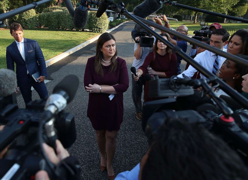 PHOTO: White House Press Secretary Sarah Huckabee Sanders speaks to the media in front of the West Wing of the White House, Sept. 5, 2018 in Washington.