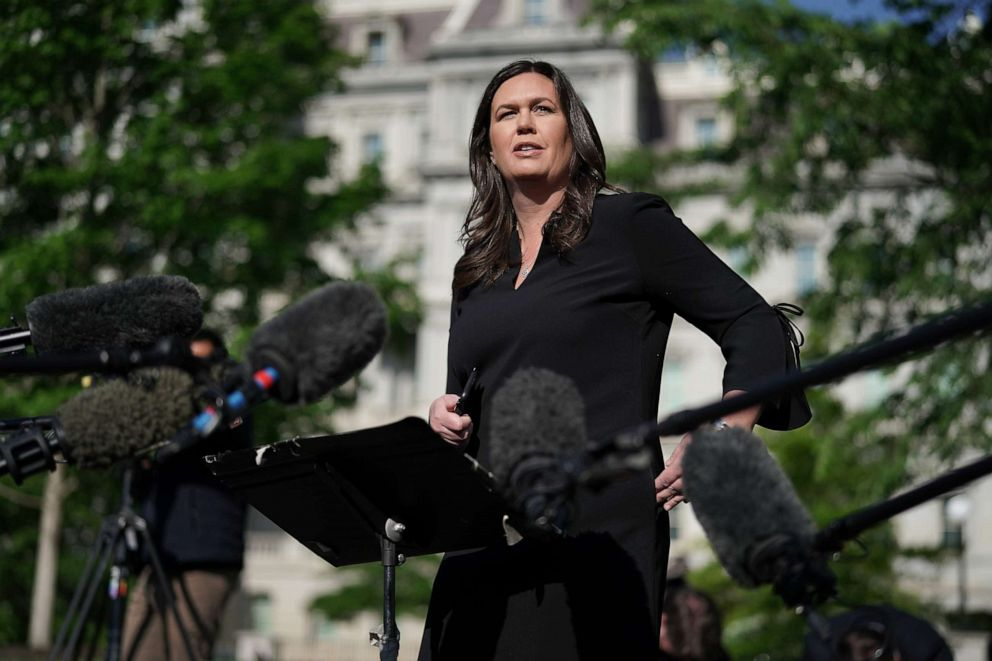 PHOTO: White House Press Secretary Sarah Sanders talks to reporters outside the White House, April 29, 2019 in Washington.