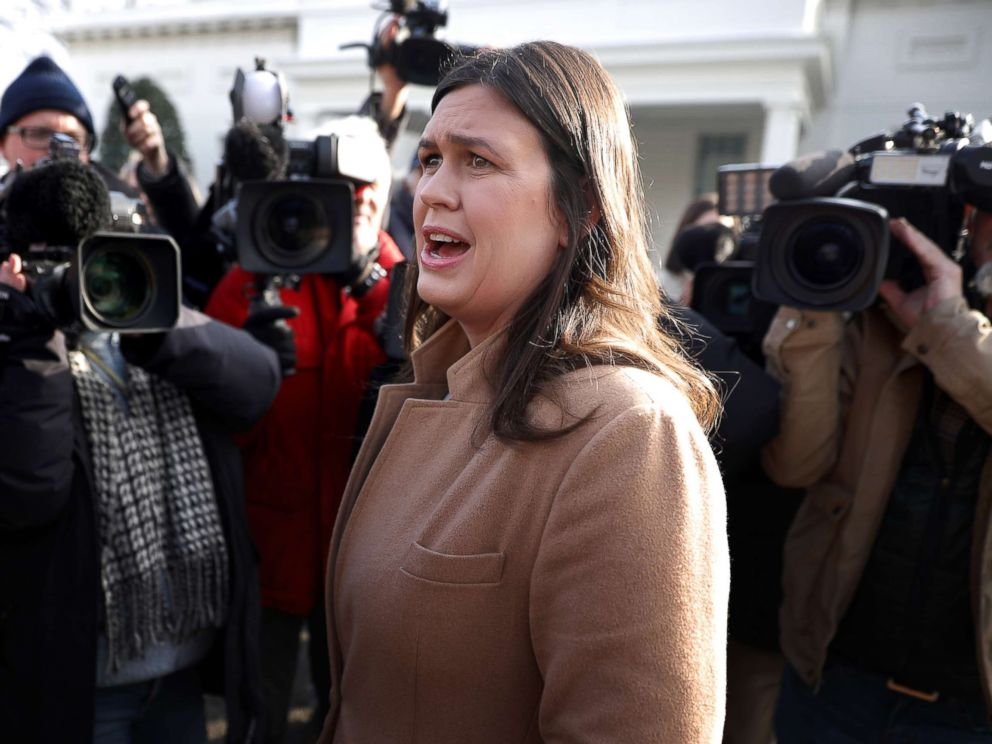 PHOTO: White House Press Secretary Sarah Huckabee Sanders talks to reporters outside the West Wing of the White House, Jan. 18, 2019.