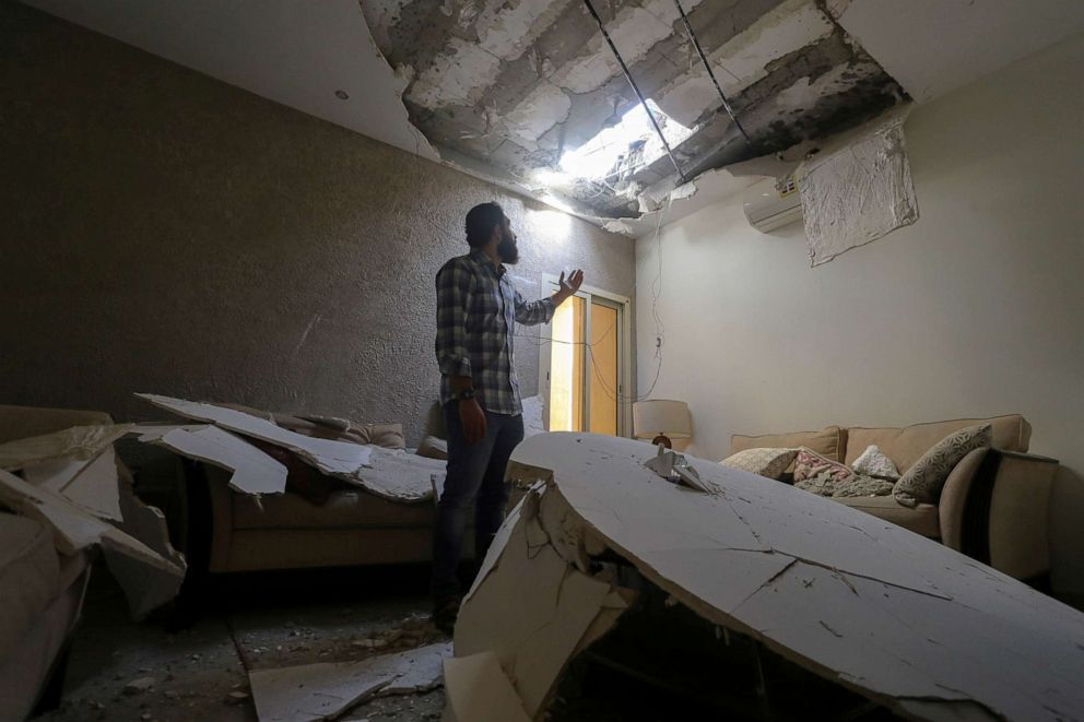 PHOTO: Mohamed Fahim inspects his house that was damaged by an intercepted missile in the aftermath of what Saudi-led coalition said was a thwarted Houthi missile attack, in Riyadh, Saudi Arabia, Feb. 28, 2021.
