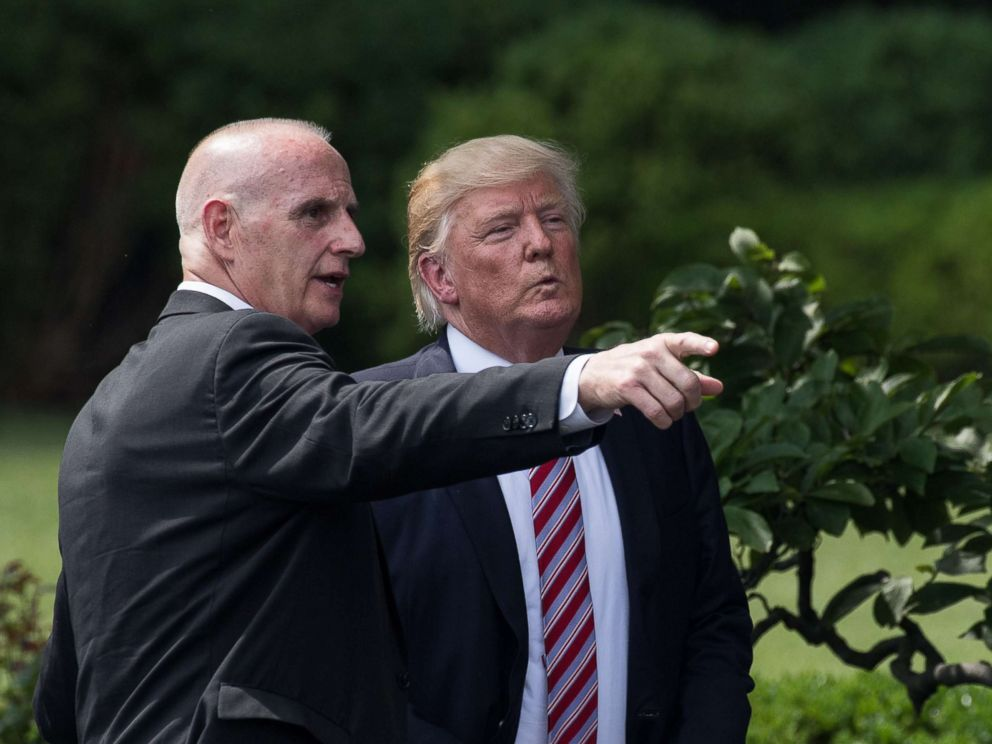 PHOTO: President Donald Trump listens to Director of Oval Office Operations Keith Schiller as he prepares to leave after welcoming the Clemson Tigers, the 2016 NCAA Football National Champions, at the White House in Washington, June 12, 2017.