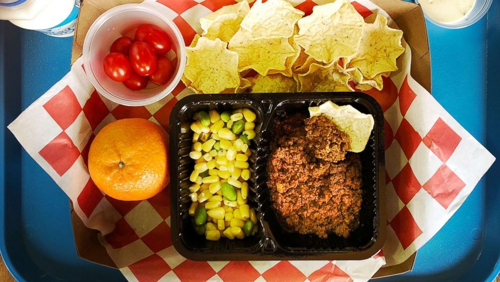 Homemade taco, tortilla chips, corn and edamame, grape tomatoes, ranch dressing, clementine & 1% milk make up a student meal at at an elementary school in Silver Spring, Md., Feb. 12, 2018.
