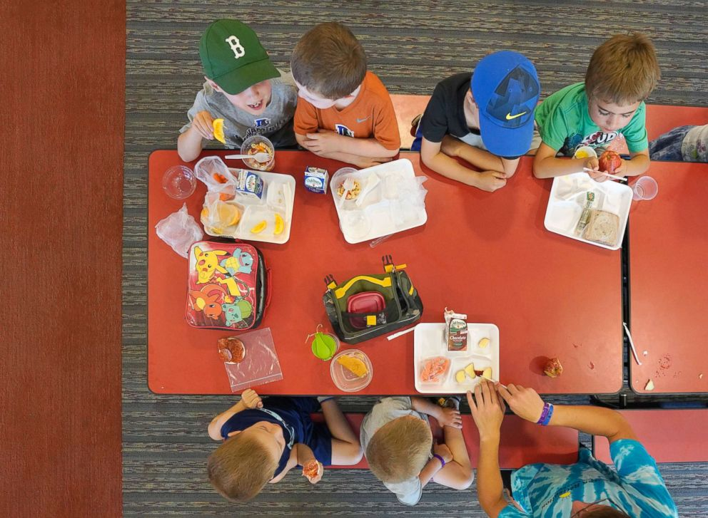 Children in a summer program eat lunch at a cafeteria in Buxton, Maine, July 12, 2018.