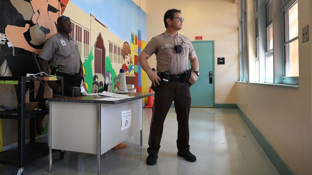 School security officers guard the the front entrance to the Kenwood K-8 Center in Miami, Fla., Aug. 24, 2018.