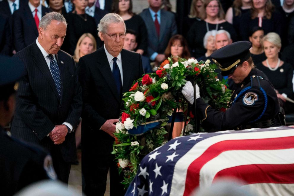 PHOTO: Senate Minority Leader Chuck Schumer and Senate Majority Leader Mitch McConnell of Kentucky watch as a wreath is placed at the casket of the late US Senator John McCain as he lies in state in the Rotunda of the Capitol, Aug. 31, 2018 in Washington.
