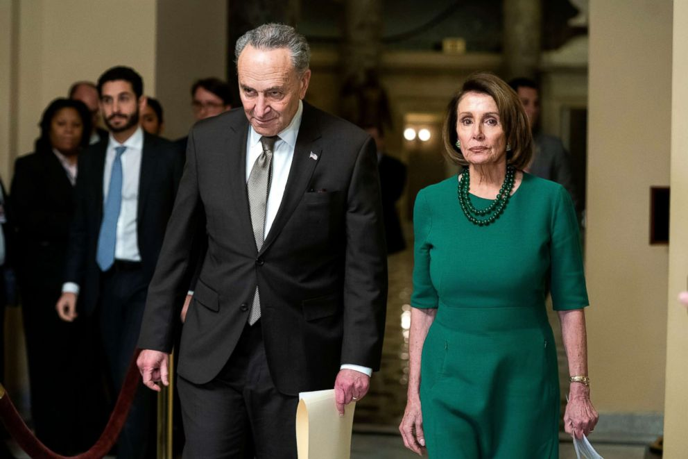 PHOTO: Nancy Pelosi, right, and Chuck Schumer arrive to speak to the media as lawmakers prepare to vote on a new budget resolution to avert a government shutdown at the US Capitol in Washington, Dec. 20, 2018.