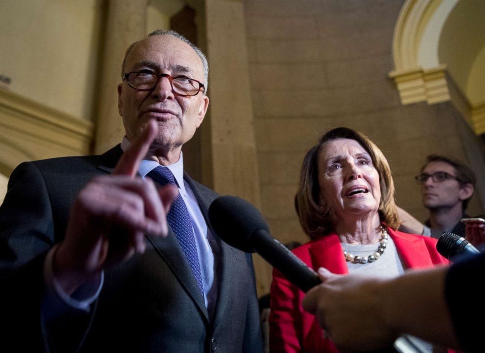 Senate Minority Leader Chuck Schumer and House Minority Leader Nancy Pelosi speak to reporters following a meeting of House and Senate leaders, March 21, 2018, in Washington.