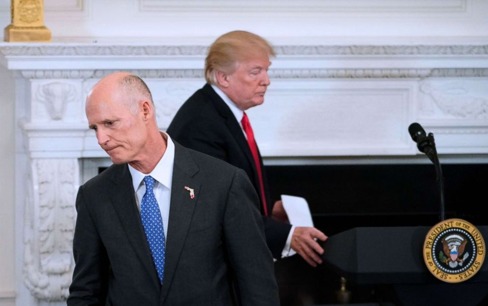 PHOTO: President Donald Trump returns to the lectern as Florida Governor Rick Scott returns to his seat after addressing the 2018 White House business session with governors in the State dining Room of the White House, Feb. 26, 2018.
