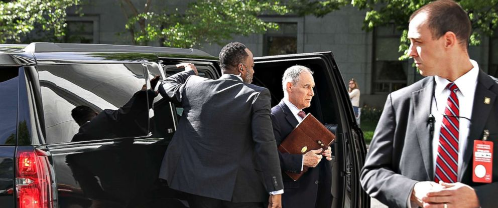 Surrounded by security agents, Environmental Protection Agency Administrator Scott Pruitt steps out of an armored SUV to testify before the House Energy and Commerce Committees Environment Subcommittee on Capitol Hill, in Washington, DC, April 26, 2018.