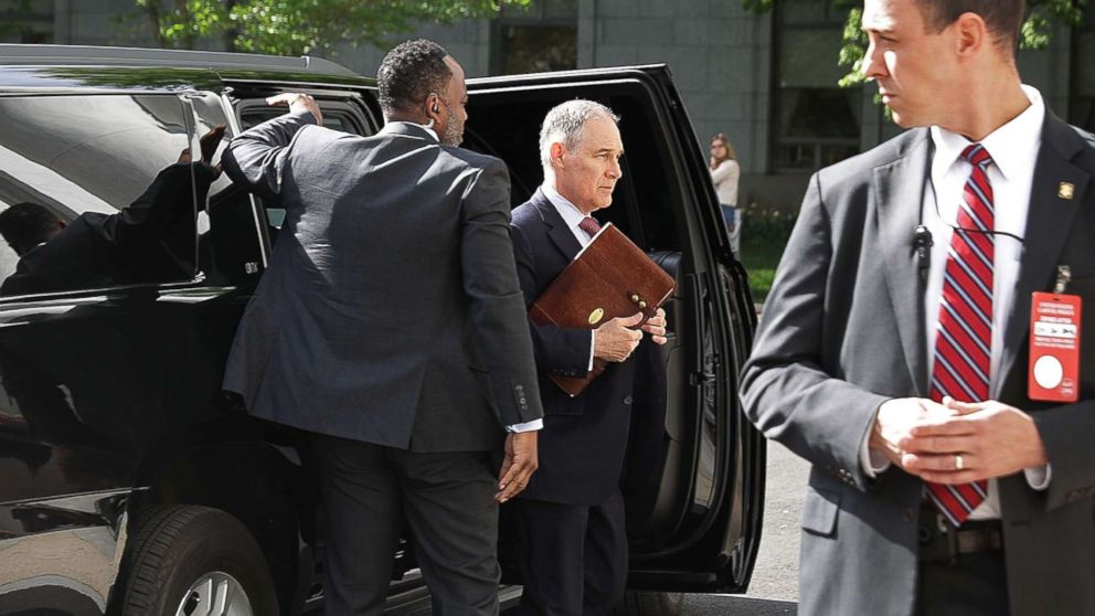 Surrounded by security agents, EPA Administrator Scott Pruitt steps out of his armored SUV as he arrives to testify before the House Energy and Commerce Committee's Environment Subcommittee on Capitol Hill April 26, 2018 in Washington.