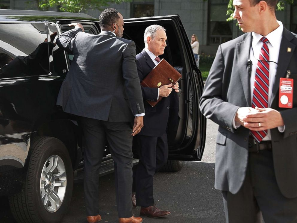 PHOTO: Surrounded by security agents, EPA Administrator Scott Pruitt steps out of his armored SUV as he arrives to testify before the House Energy and Commerce Committees Environment Subcommittee on Capitol Hill April 26, 2018 in Washington.