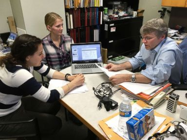 PHOTO: University of Wisconsin-Madison chemistry professor Robert Hamers confers with junior Alice Horein and doctoral candidate Sarah Guillot on their research projects during a meeting on campus on March 6, 2017.