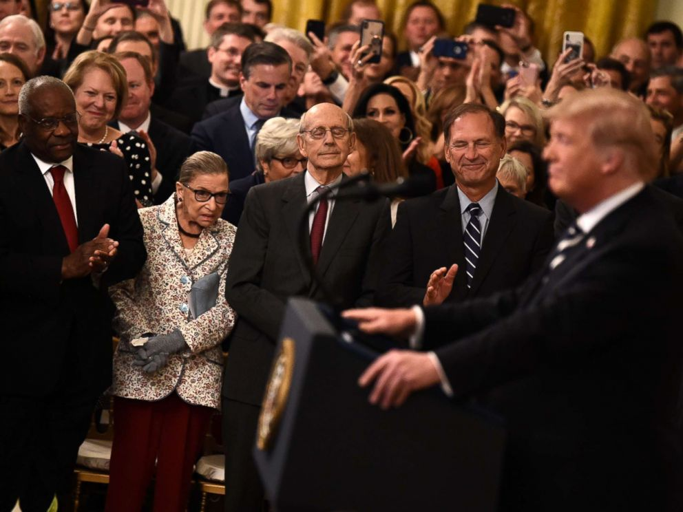 PHOTO: Supreme Court Associate Justices Clarence Thomas, Ruth Bader Ginsburg, Stephen Breyer and Samuel Alito listen as President Trump speaks during the swearing-in of Brett Kavanaugh as Associate Justice in Washington, Oct. 8, 2018.