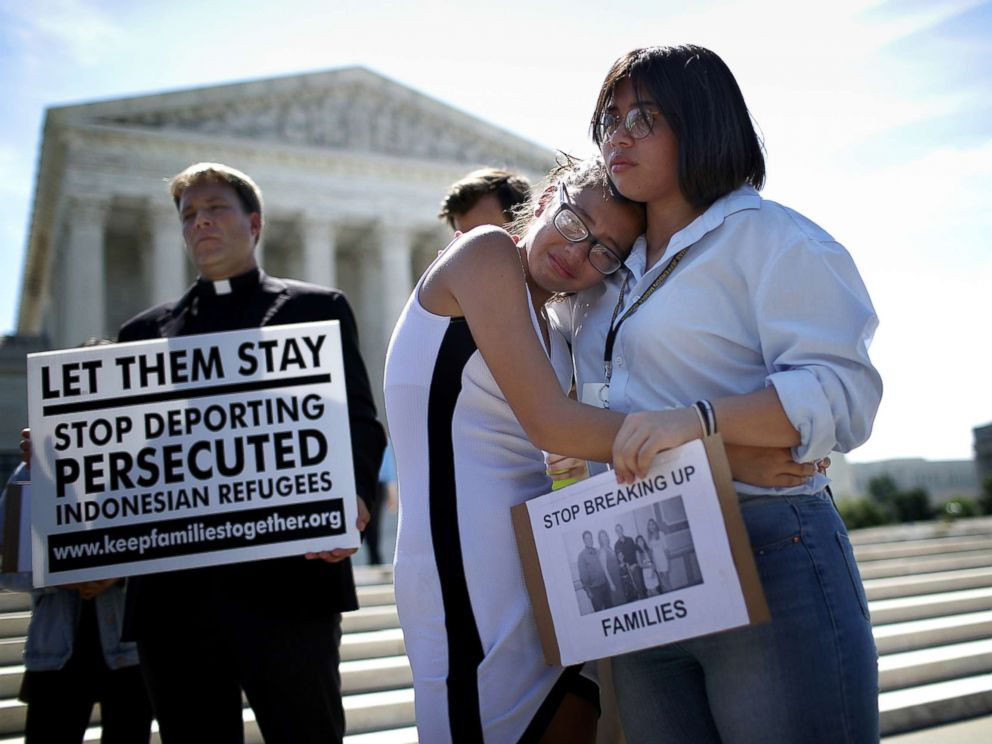 PHOTO: Sisters Michelle Edralin and Nicole Edralin, right, from Highland Park, console one another outside the U.S. Supreme Court as the court issued an immigration ruling June 26, 2018 in Washington, D.C., upholding President Trumps travel ban.