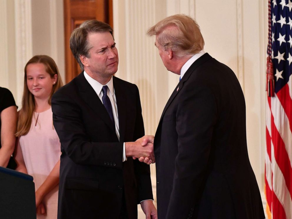 PHOTO: Supreme Court nominee Brett Kavanaugh shakes hands with President Donald Trump after he announced his nomination in the East Room of the White House on July 9, 2018 in Washington.