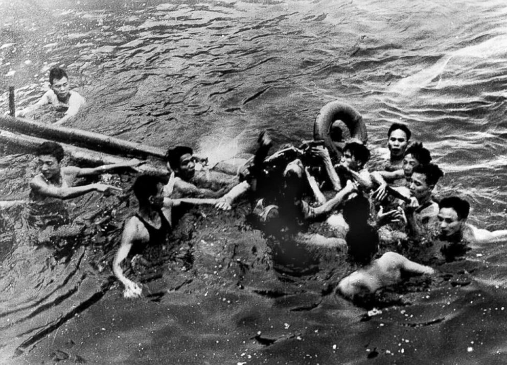 Navy Airforce Major John McCain, center, is rescued from Hanoi's Truc Bach lake by several Hanoi residents after his warplane was downed by the Northern Vietnamese army during the Vietnam War.
