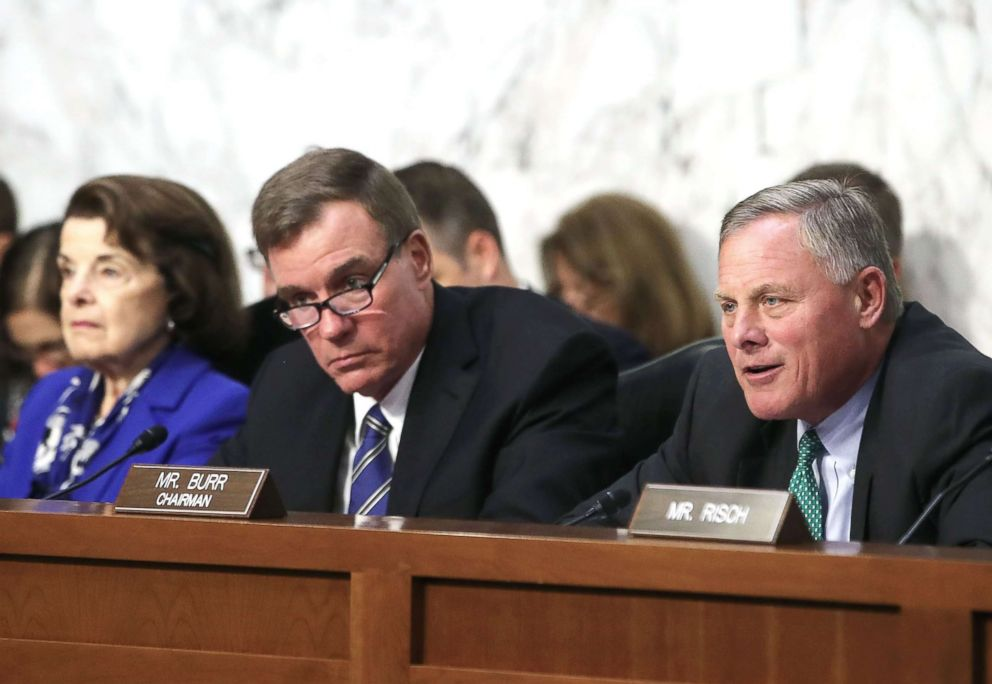 PHOTO: Chairman Richard Burr (R), speaks while flanked by ranking member Sen. Mark Warner (C), and Sen. Dianne Feinstein, during a Senate Intelligence Committee hearing, on Capitol Hill August 1, 2018 in Washington, D.C.