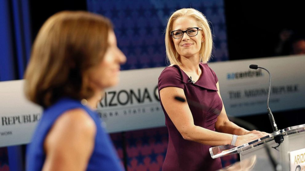 U.S. Senate candidates, Rep. Martha McSally, R-Ariz., left, and Rep. Kyrsten Sinema, D-Ariz., prepare their remarks in a television studio prior to a televised debate, Oct. 15, 2018, in Phoenix.