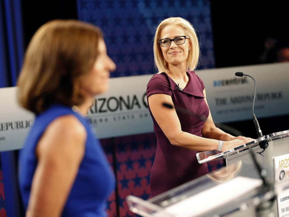PHOTO: Senate candidates Rep. Martha McSally, left, and Rep. Kyrsten Sinema, prepare their remarks in a television studio prior to a televised debate, Oct. 15, 2018, in Phoenix.