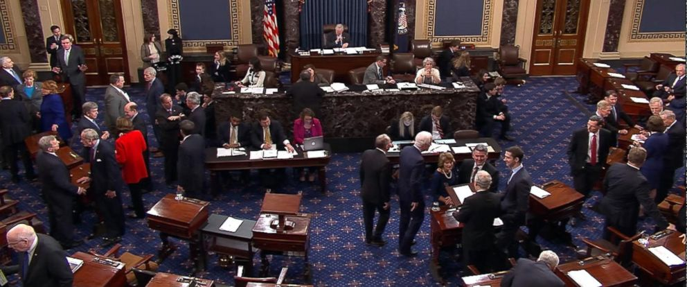 PHOTO: In this image made from video, members congregate on the floor of the U.S. Senate in Washington, Jan. 22, 2018.