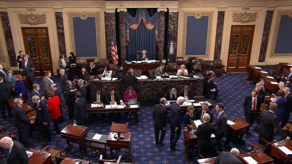 In this image made from video, members vote on a temporary funding measure to end the government shutdown on the floor of the U.S. Senate in Washington, Jan. 22, 2018.