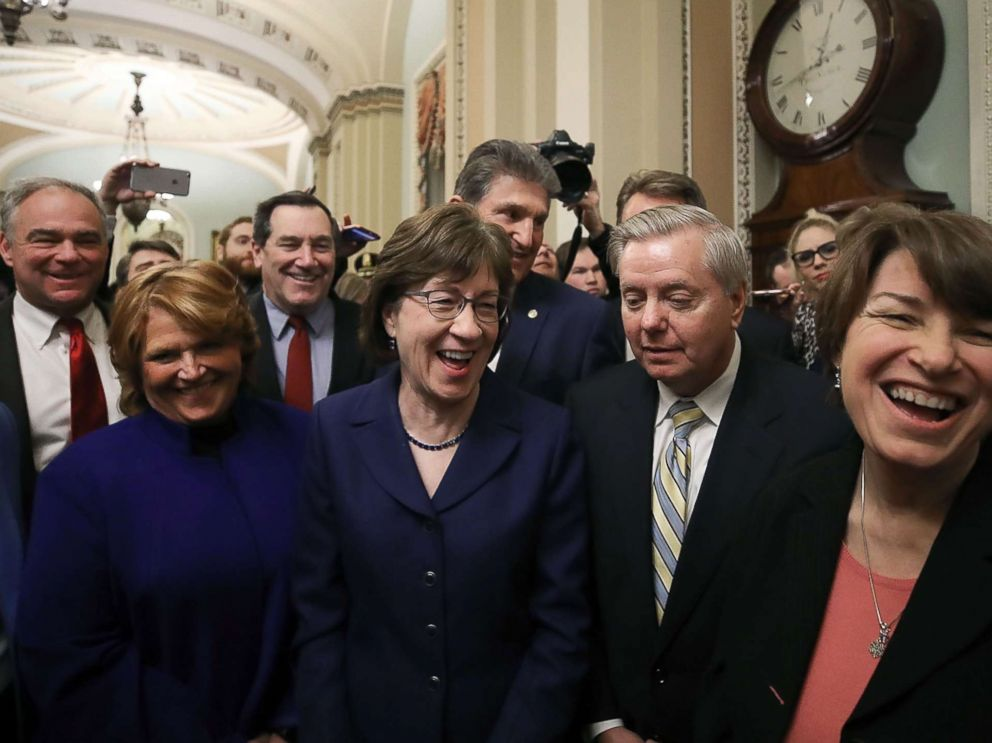 PHOTO: Sen. Susan Collins stands with Sen. Lindsey Graham and other fellow Senators after the Senate voted and passed a resolution to reopen the government, at the U.S. Capitol on Jan. 22, 2018 in Washington.