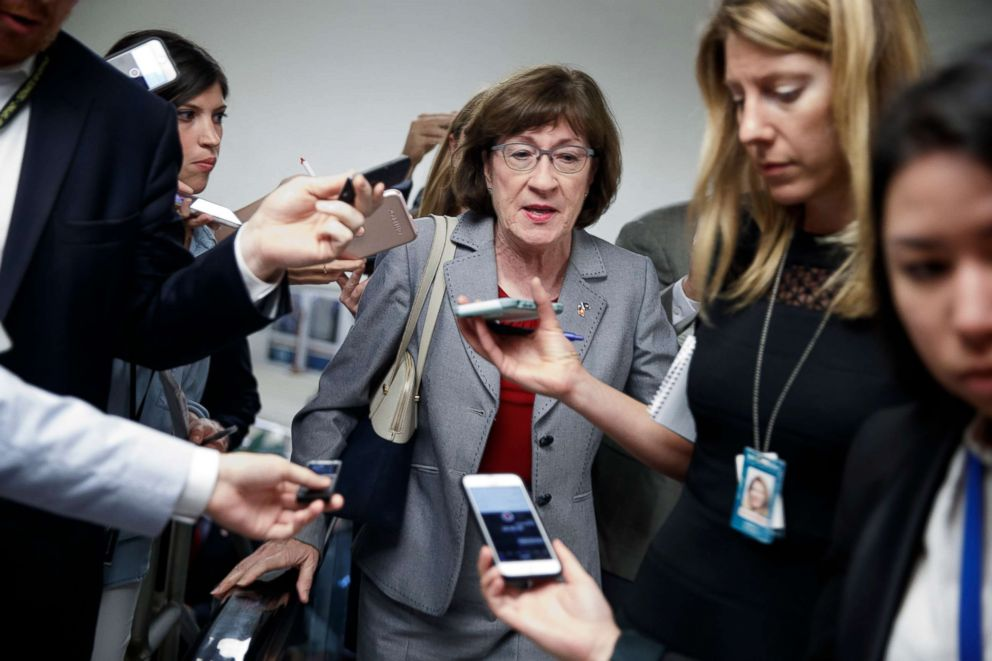 PHOTO: Senator Susan Collins talks to the media while walking through the U.S. Capitol in Washington, Sept. 18, 2018.