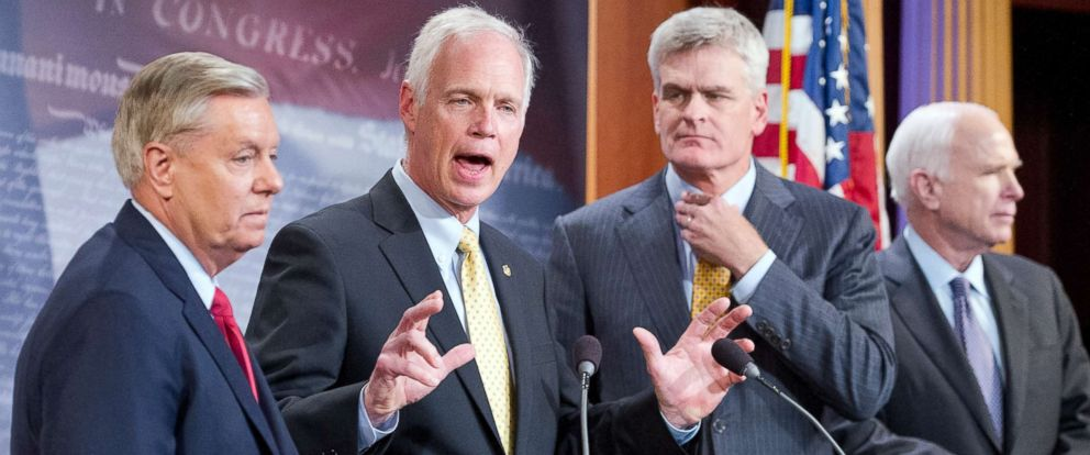 PHOTO: Sen. Ron Johnson, center, makes a statement, July 27, 2017, at the Capitol in Washington, D.C.