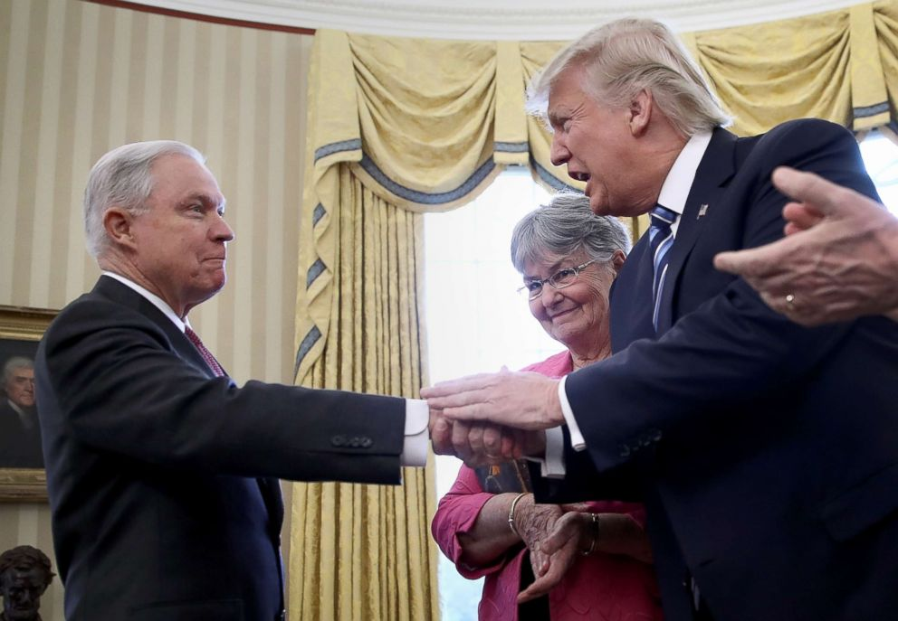 PHOTO: President Donald Trump shakes the hand of Jeff Sessions after he was sworn in as the new U.S. Attorney General in the Oval Office of the White House, Feb. 9, 2017.