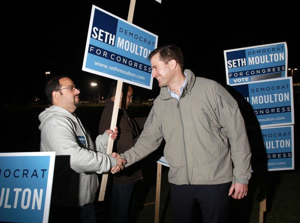 PHOTO: Seth Moulton, right, greets supporter Philip DAgaati outside North Andover High School in North Andover, Mass., Nov. 4, 2014.