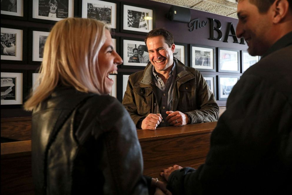 PHOTO: Rep. Seth Moulton meets with patrons after participating in the Pints and Politics event held at The Barley House in Concord, N.H., March 16, 2019.