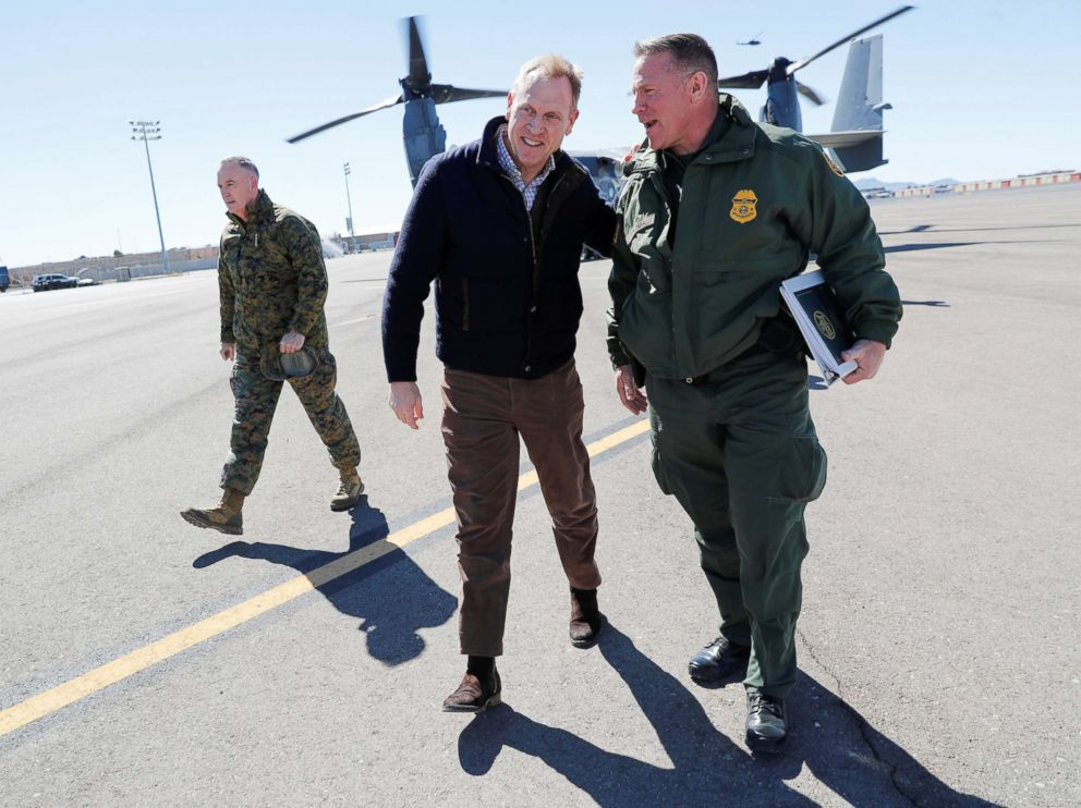 PHOTO: Acting Secretary of Defense Patrick Shanahan, center, talks with El Paso Sector Chief Aaron Hull, right, at El Paso International airport after doing a Osprey aircraft tour of the U.S.-Mexico border, Feb. 23, 2019.
