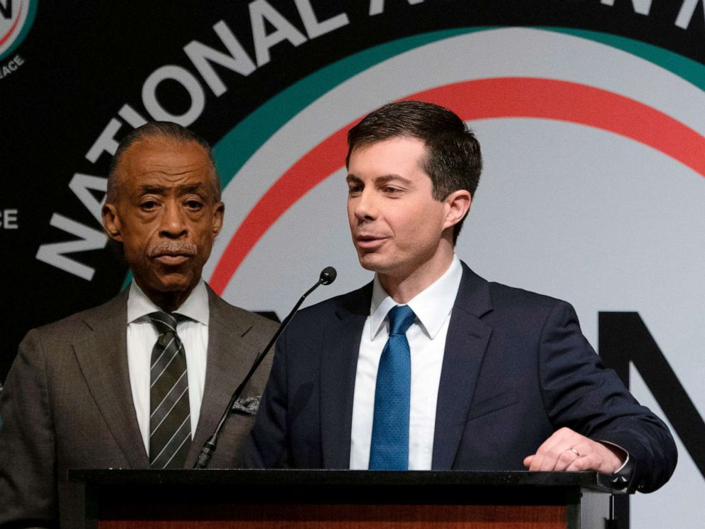 PHOTO: Democratic Presidential candidate Pete Buttigieg, with the Reverend Al Sharpton, speaks during a gathering of the National Action Network, April 4, 2019, in N.Y.